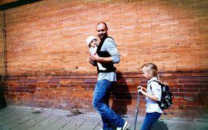 Man walking with 2 kids