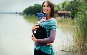 Mother and baby near a lake