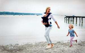 Mother and child running at a lake