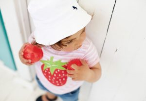 child with strawberry shirt
