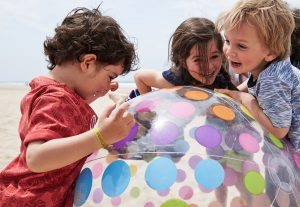 children playing with beachball