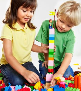 kids building a lego tower
