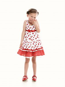 laughing girl in summer dress