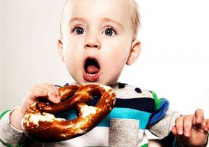 baby eating a brezel