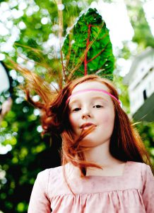 girl with leaf in her hair