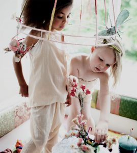 girls playing with flowers