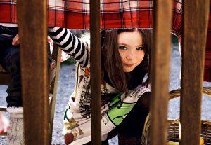 girl underneath the table