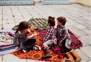 children having a picnic outside