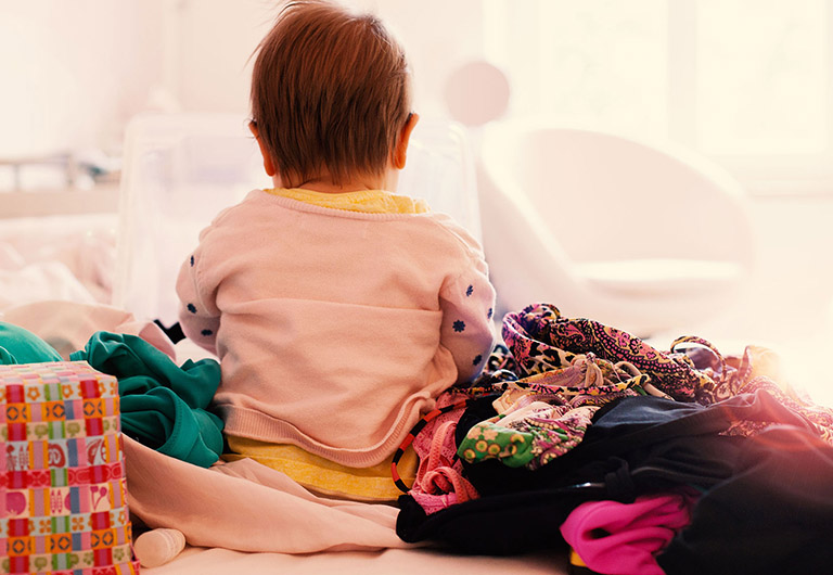 baby playing with different cloths