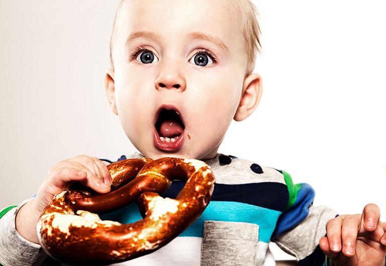 boy eating a brezel