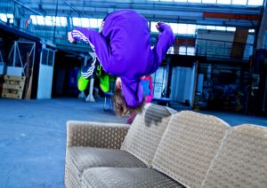 boy doing a flip jump