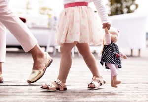 girl walking after her mother