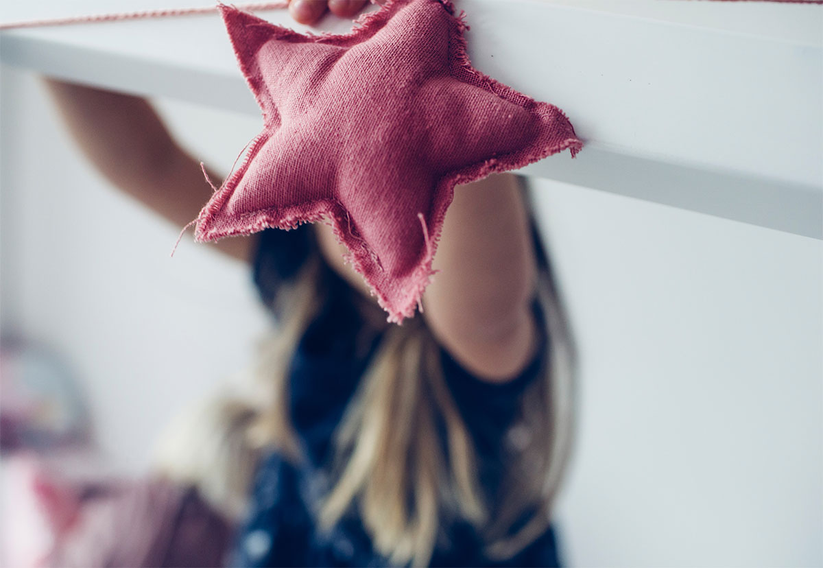 child holding a star