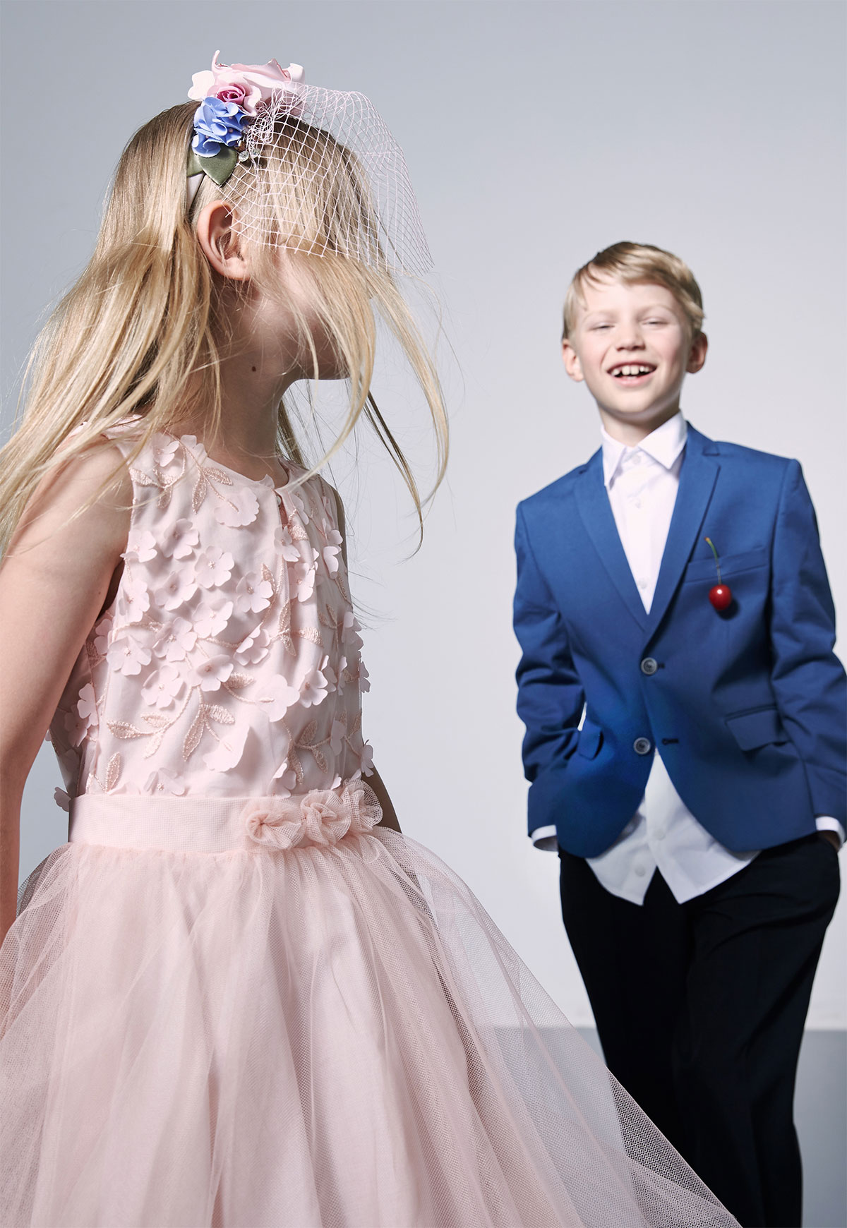 boy in suit and girl in dress