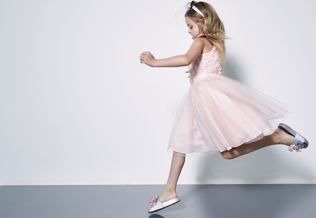 girl jumping in dress