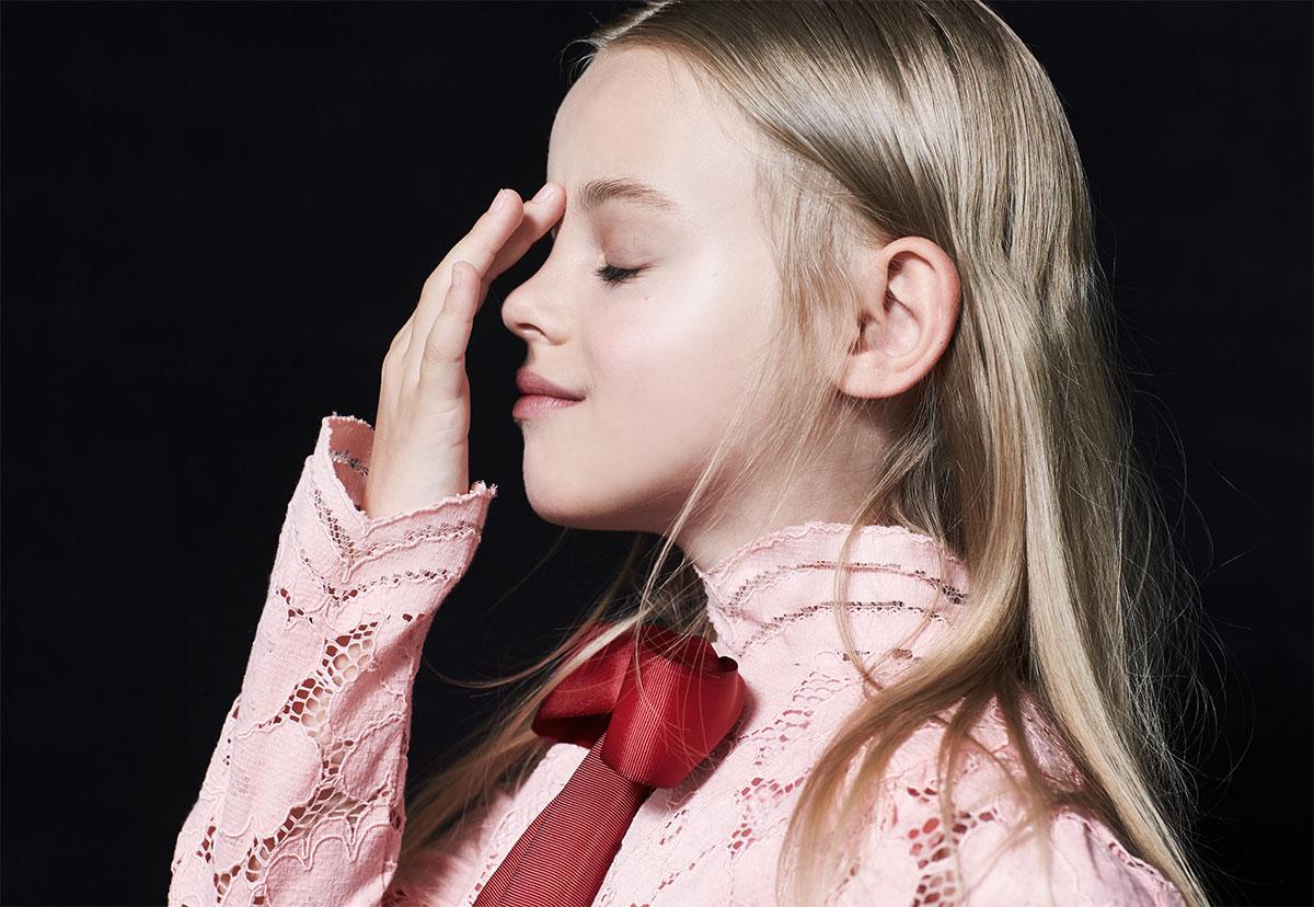 girl touching nose